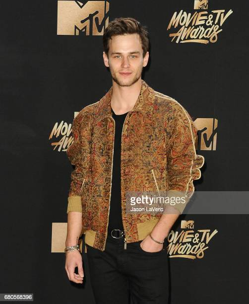 Actor Brandon Flynn poses in the press room at the 2017 MTV Movie and TV Awards at The Shrine Auditorium on May 7 2017 in Los Angeles California