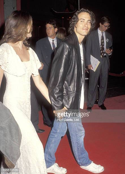 Actor Brandon Lee and girlfriend Eliza Hutton attend The Last of the Mohicans Hollywood Premiere on September 24, 1992 at Mann's Chinese Theatre in...