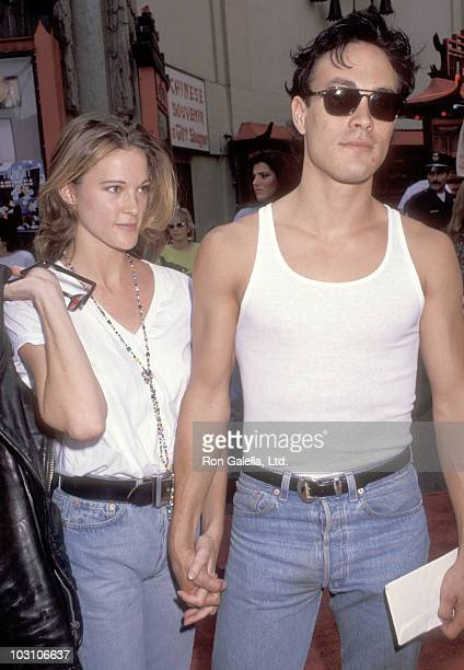 Actor Brandon Lee and girlfriend Eliza Hutton attend the 'Little Man Tate' Hollywood Premiere on October 6 1991 at Mann's Chinese Theatre in...