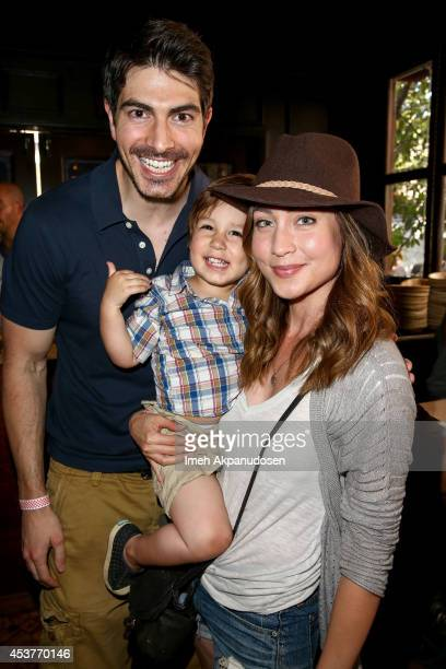 Actor Brandon Routh and actress Courtney Ford with their son Leo James Routh attend Crab Cake 2014 presented by S Pellegrino Samsung Galaxy on August...