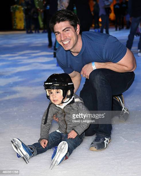 Actor Brandon Routh and son Leo James Routh attend Disney On Ice presents Let's Celebrate at Staples Center on December 11 2014 in Los Angeles...