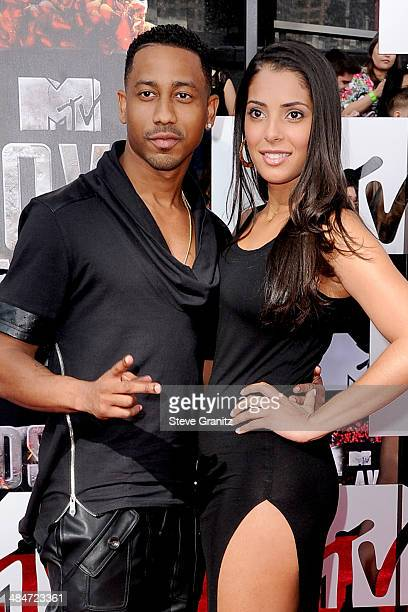 Actor Brandon T Jackson and Denise Marie Xavier attend the 2014 MTV Movie Awards at Nokia Theatre LA Live on April 13 2014 in Los Angeles California
