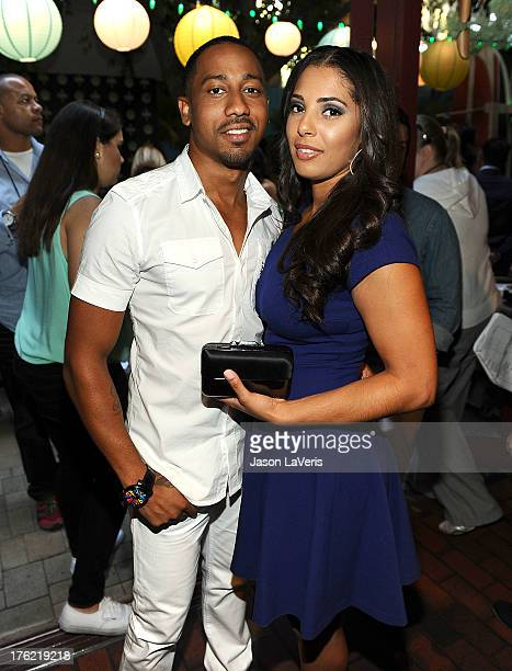 Actor Brandon T Jackson and Denise Marie Xavier pose in the green room at the 2013 Teen Choice Awards at Gibson Amphitheatre on August 11 2013 in...