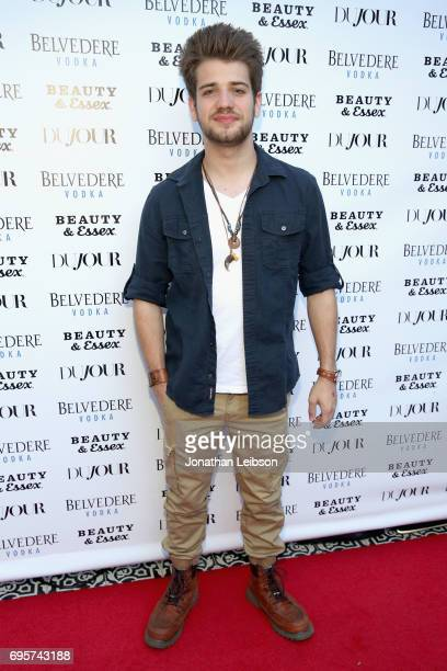 Actor Brandon Tyler Russell attends DuJour's Summer Issue Cover Party with Lily James presented by Belvedere Vodka at Beauty Essex on June 12 2017 in...