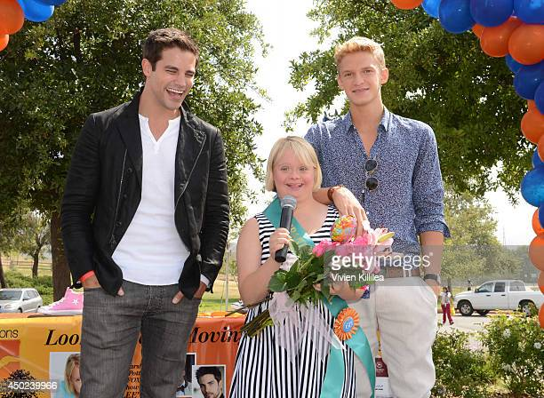 Actor Brant Daugherty and singer Cody Simpson present actress Lauren Potter with flowers at the New Horizons 5K Run/Walk on June 7 2014 in Los...