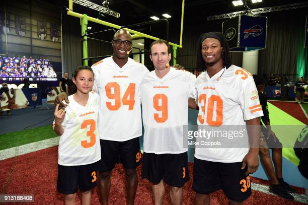 Actor Breanna Yde former NFL player DeMarcus Ware and NFL players Drew Brees and Todd Gurley attend the Superstar Slime Showdown taping at...