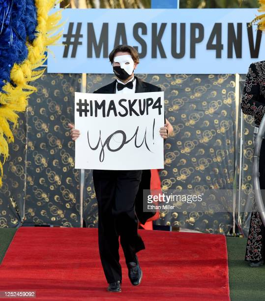 Actor Brent Barrett participates in a fashion show in front of the Welcome to Fabulous Las Vegas sign on the Las Vegas Strip to kick off the promask...