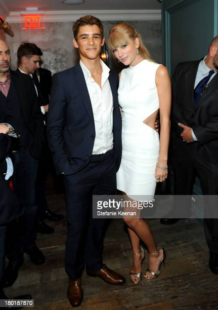 Actor Brenton Thwaites and singer Taylor Swift at the Grey Goose vodka party for The Weinstein Company and eOne Entertainment's 'August Osage County'...