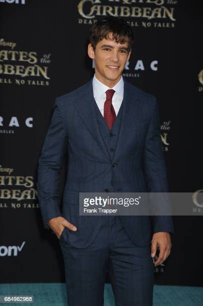 Actor Brenton Thwaites arrives at the premiere of Disney's Pirates of the Caribbean Dead Men Tell No Tales at the Dolby Theatre on May 18 2017 in...