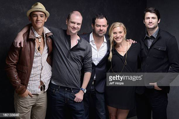Actor Brenton Thwaites director Mike Flanagan actor Rory Cochrane actress Katee Sackhoff and actor James Lafferty of 'Oculus' pose at the Guess...