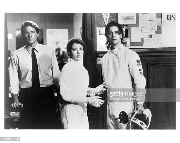 Actor Brett Cullen and actress Mia Sara and Christopher Rydell on set of the movie By the Sword circa 1991