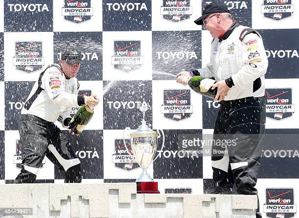 Actor Brett Davern and professional driver Al Unser Jr elebrate after winning the 37th Annual Toyota Pro/Celebrity Race on April 12 2014 in Long...