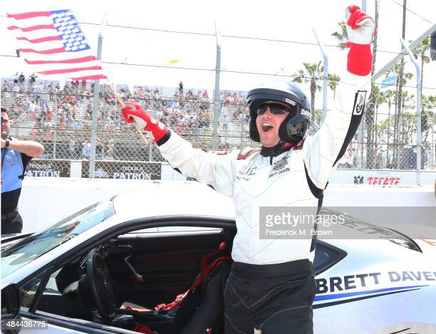 Actor Brett Davern celebrates after winning the 37th Annual Toyota Pro/Celebrity Race on April 12 2014 in Long Beach California
