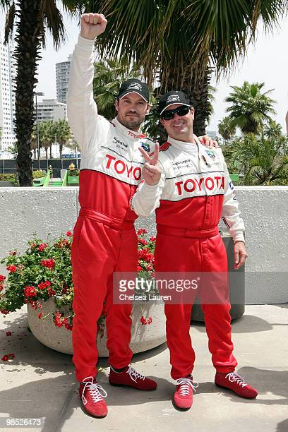 Actor Brian Austin Green and professional racecar driver Jimmy Vasser pose after winning the Toyota Grand Prix Pro / Celebrity Race Day on April 17...