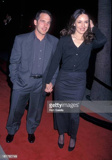 Actor Brian Benben and actress Madeleine Stowe attend the Amistad Beverly Hills Premiere on December 8 1997 at the Samuel Goldwyn Theatre in Beverly...