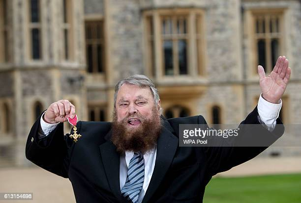 Actor Brian Blessed poses after he is made an Officer of the Order of the British Empire by Queen Elizabeth II during an Investiture ceremony at...
