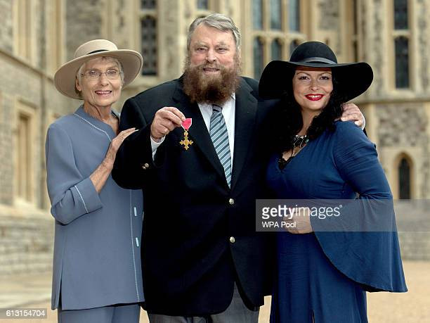 Actor Brian Blessed with his wife Hildegard and daughter Rosalind poses after he is made an Officer of the Order of the British Empire by Queen...