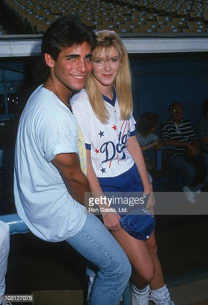 Actor Brian Bloom and actress Allison Smith attend Hollywood AllStars Baseball Game on August 20 1988 at Dodger Stadium in Los Angeles California