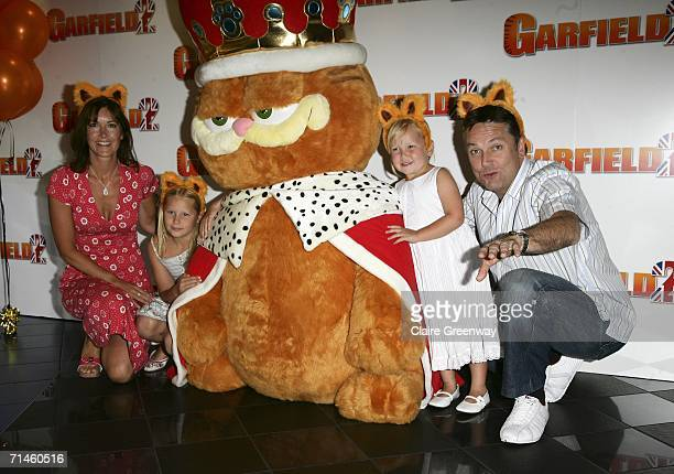 """Actor Brian Conley , his wife Anne-Marie and daughters Amy and Lucy arrive at the UK Gala Screening of """"Garfield 2: A Tail Of Two Kitties"""" at Vue..."""