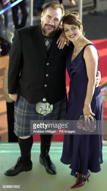 Actor Brian Cox and his wife Nicole AnsariCox arriving for the XMen 2 charity film premier at the Warner Village Cinema complex in Edinburgh