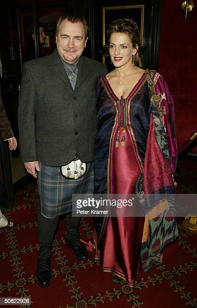 """Actor Brian Cox and wife Nicole Ansari attend the premiere of """"Troy"""" on May 10, 2004 in New York City."""