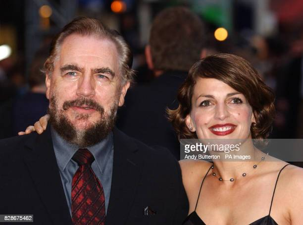 Actor Brian Cox poses with his wife Nicole AnsariCox at the Odeon West End London for the UK premiere of XMen 2