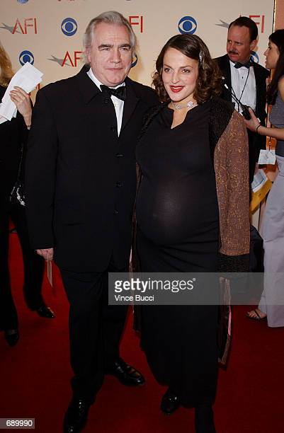 Actor Brian Cox with his girlfriend attend the American Film Institutes AFI Awards 2001 at the Beverly Hills Hotel January 5 2002 in Beverly Hills CA