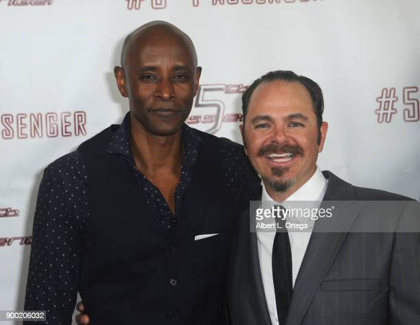 Actor Brian Keith Gamble and director Scott Baker arrive for the Cast And Crew Screening Of 5th Passenger held at TCL Chinese 6 Theatres on December...