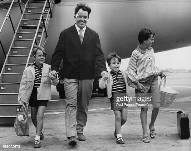 Actor Brian Rix actormanager of the Whitehall Theatre arrives back from a holiday in Spain with his children James Jonathan and Louisa at London...
