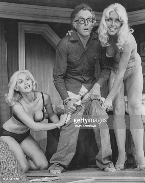 Actor Brian Rix pictured during rehearsals for his new show 'A Bit Between the Teeth' with bikini clad actresses Donna Reading and Vivienne Johnson...