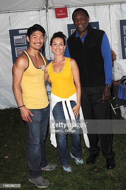 Actor Brian Tee actress Mirelly Taylor and athlete Rafer Johnson participate in the 2012 Special Olympics Summer Games day 1 held at California State...