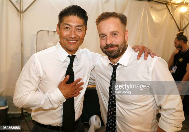 Actor Brian Tee and Tenor Alfie Boe attend the 2018 National Memorial Day Concert Rehearsals at US Capitol West Lawn on May 26 2018 in Washington DC