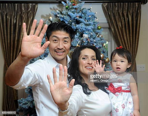 """Actor Brian Tee of NBC's """"Chicago Med"""", wife/actree Mirelly Taylor and daughter Madeline Skyer Tee give the high five in front of the Christmas Tree..."""