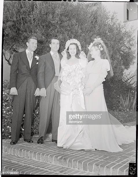 Actor Bruce Cabot best man Mr and Mrs Pasquale 'Pat' DiCicco and Shirley Cowan maid of Honor pose for cameramen after marriage of the actor's agent...