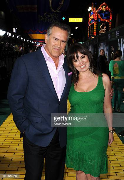 Actor Bruce Campbell and Ida Gearon attend the world premiere of Walt Disney Pictures' Oz The Great And Powerful at the El Capitan Theatre on...