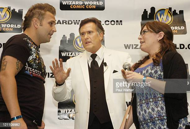 Actor Bruce Campbell talks just before Jeremie Bailey proposes to his girlfriend AJ Zettler at the Bruce Campbell question and answer session at the...