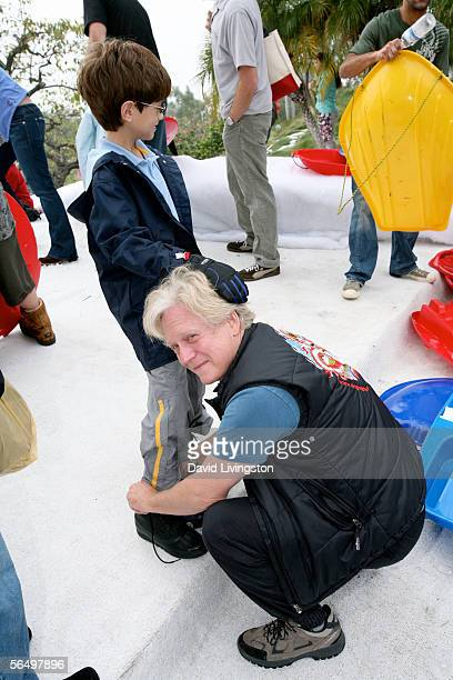Actor Bruce Davidson adjusts his son Ethan's snow gear at the home of John Paul DeJoria CEO and cofounder of John Paul Mitchell Haircare Systems...