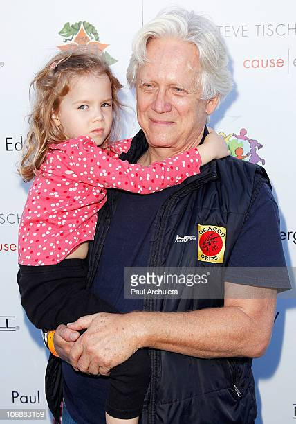 Actor Bruce Davidson with his daughter arrive at the Children Uniting Nations' 12th annual Day Of The Child event at Star Eco Station on November 14...