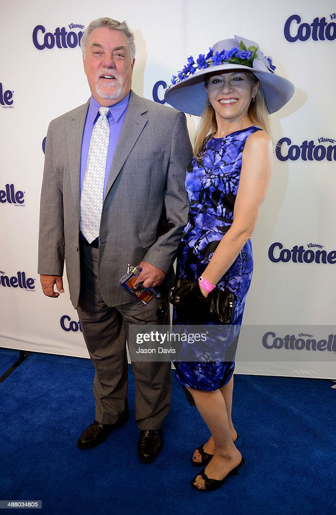 Actor Bruce McGill (L) and Gloria Lee attend Cottonelle Celebrity 'Clean Room' at the 140th Kentucky Derby at Churchill Downs on May 3, 2014 in Louisville, Kentucky.