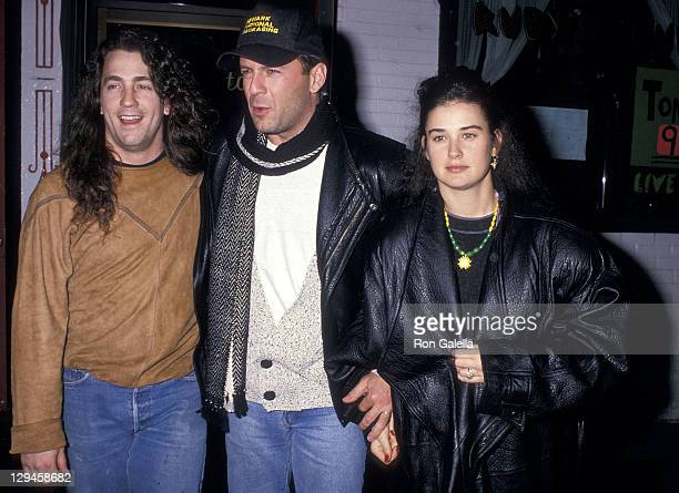 Actor Bruce Willis actress Demi Moore and friend on February 15 1988 dine at Ruby's River Road Cafe in New York City