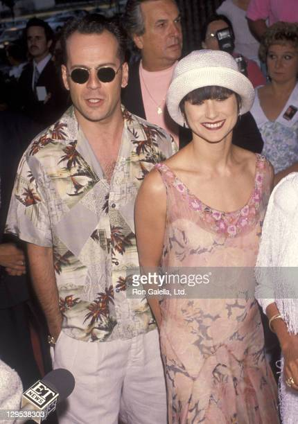 Actor Bruce Willis and actress Demi Moore attend the Die Hard 2 Westwood Premiere on July 2 1990 at the Avco Centre Cinemas in Westwood California