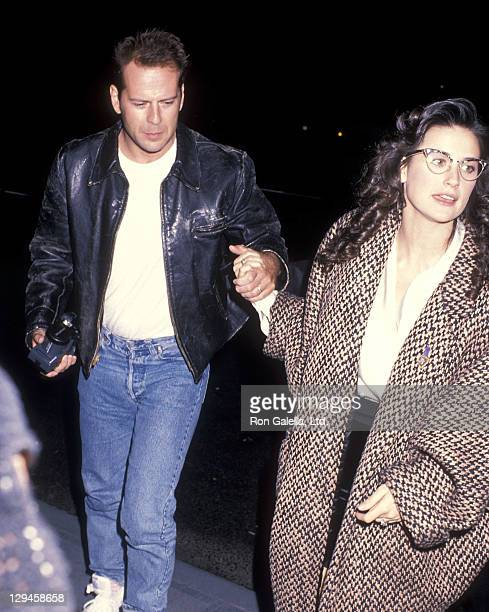 Actor Bruce Willis and actress Demi Moore attend the Saturday Night Live After Party on November 12 1988 at 43rd Street Bar in New York City