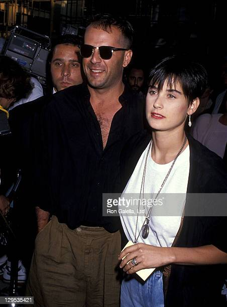 Actor Bruce Willis and actress Demi Moore attend the When Harry Met Sally Beverly Hills Premiere on July 13 1989 at the Samuel Goldwyn Theatre in...