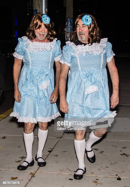 Actor Bruce Willis and assistant Stephen J Eads are seen arriving at film director M Night Shyamalan's Halloween party 'Shyamaween' on October 28...