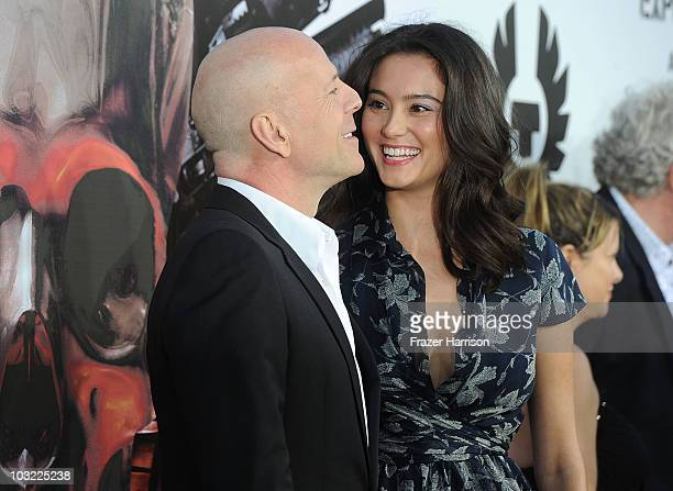 Actor Bruce Willis and Emma Heming arrives at the Premiere Of Lionsgate Films' The Expendables at the Grauman's Chinese Theatre on August 3 2010 in...