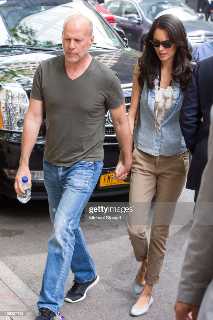 Actor Bruce WIllis (L) and Emma Heming Willis seen on the streets of Manhattan on May 10, 2013 in New York City.