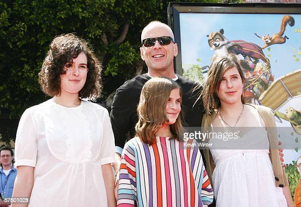 """Actor Bruce Willis and his daughters Rumer, Tallulah and Scout arrive at the premiere of DreamWorks' """"Over The Hedge"""" at the Village Theatre on April..."""