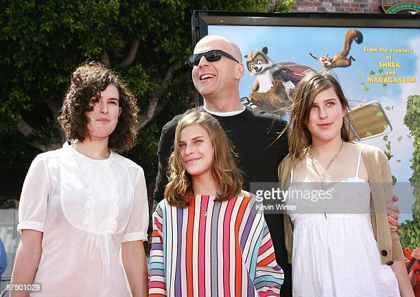 """Actor Bruce Willis and his daughters Rumer, Tallulah and Scout arrive at the premiere of DreamWorks' """"Over The Hedge"""" at the Village Theater on April..."""