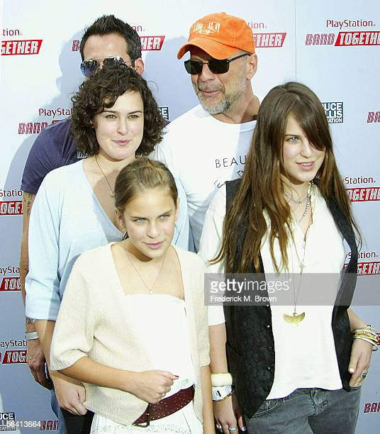 Actor Bruce Willis and his daughters Rumer, Tallulah and Scout attend the Bruce Willis Foundation Presents PlayStation BANDtogether at Smashbox...
