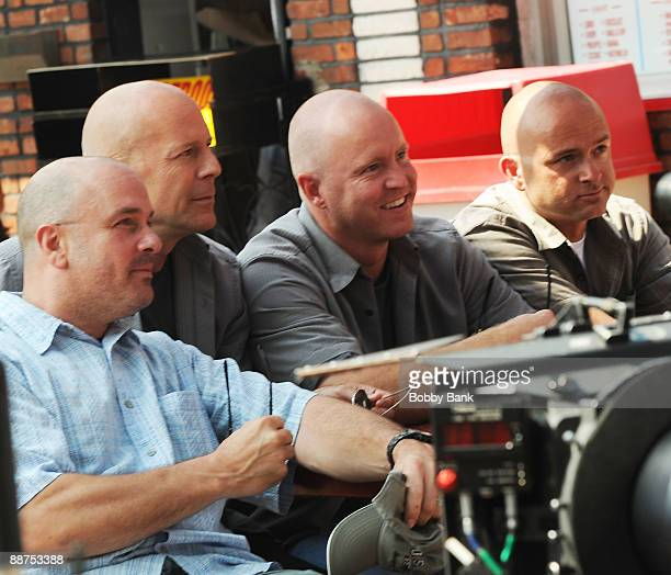"Actor Bruce Willis and his ""doubles"" on location for ""A Couple of Dicks"" at L&B's Spumoni Gardens in Brooklyn on June 29, 2009 in New York City."